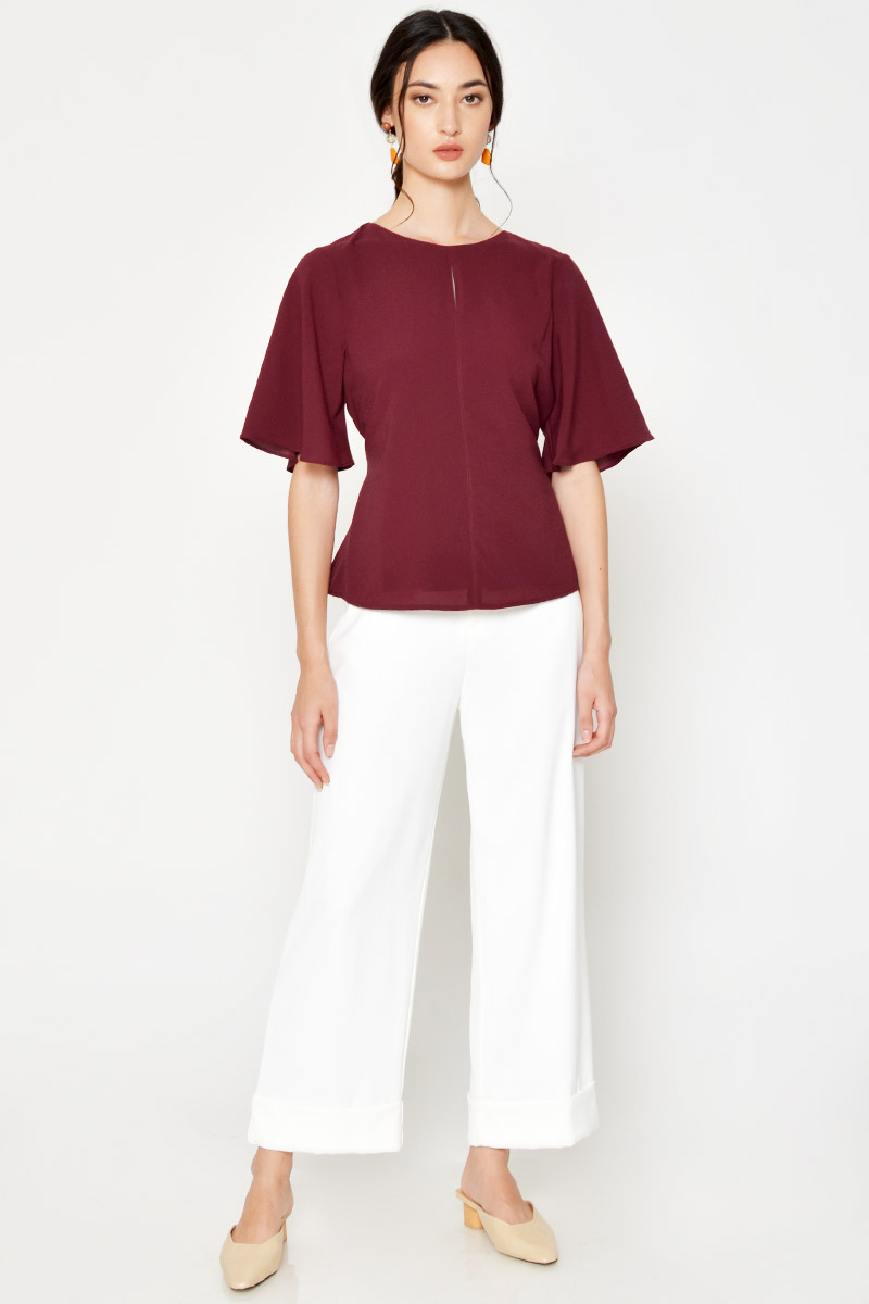 JANESE FLUTTER SLEEVE TOP W SASH