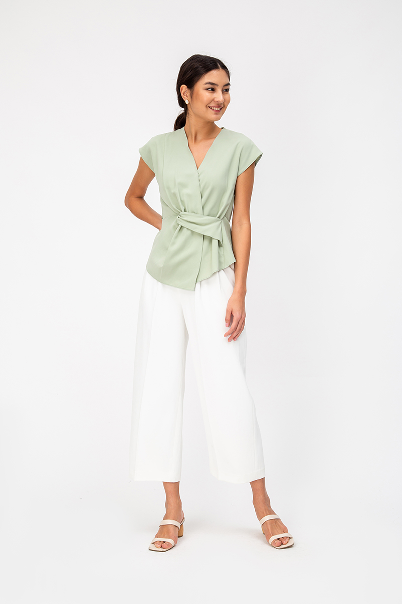COREENA TWIST ASYMMETRICAL TOP